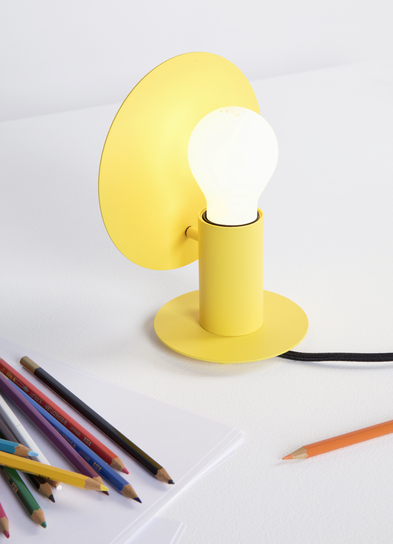 Yellow design table lamp with round shade